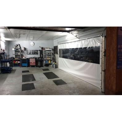 Bâche coulissante pour atelier dans un garage automobile
